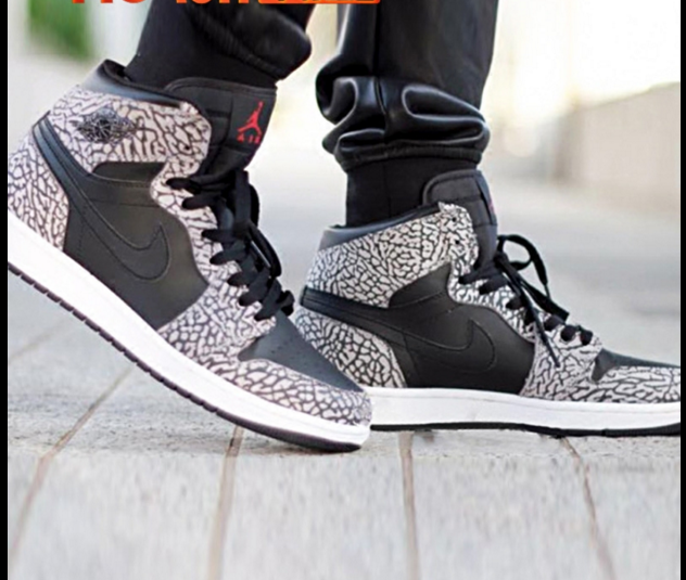 The iconic Air Jordan 1 in Black Elephant Print is showcased in an on-foot  perspective. The sneaker is scheduled to arrive in January