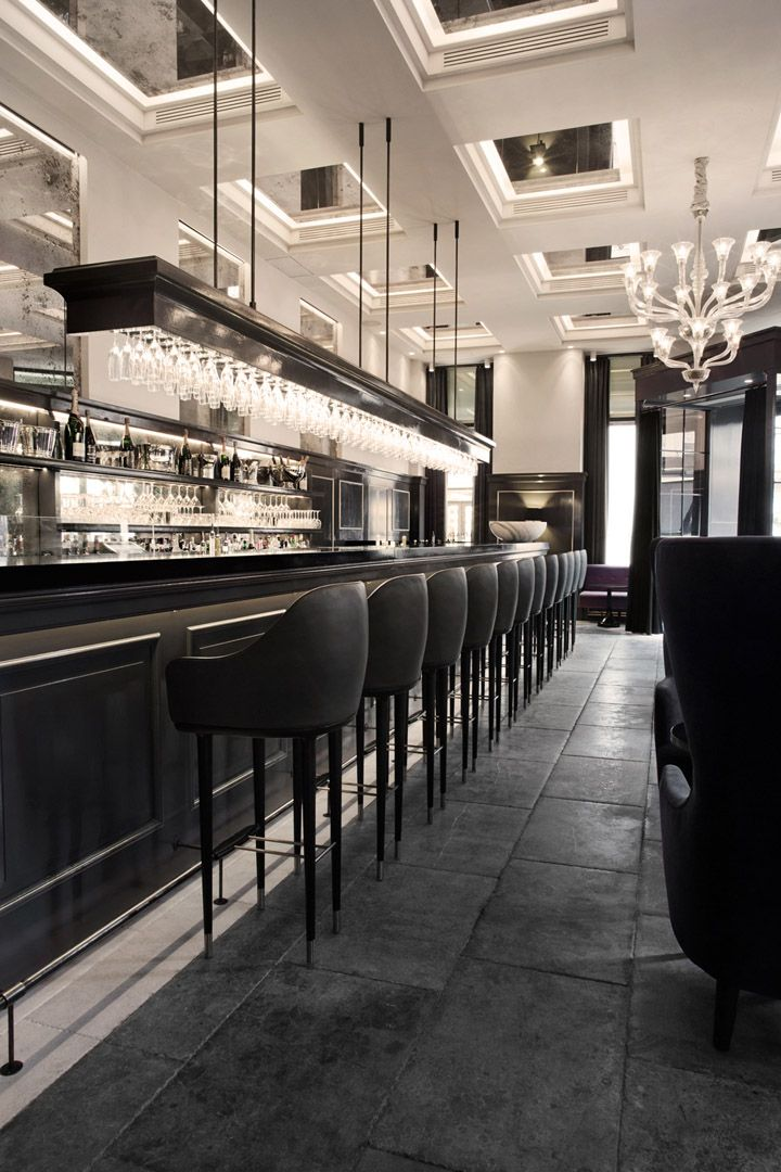 Balthazar Champagne Bar by SPACE Copenhagen   The feature ceiling is so effective in this design, the space now appears to be bigger through such a simple idea.