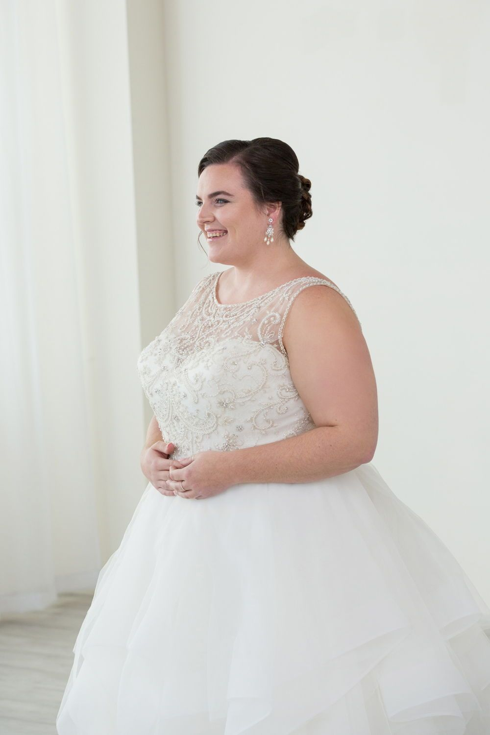 751837a774b56 Gorgeous plus size ballgown wedding dress. Beaded bodice and layered skirt. Plus  size wedding gown by Justin Alexander.