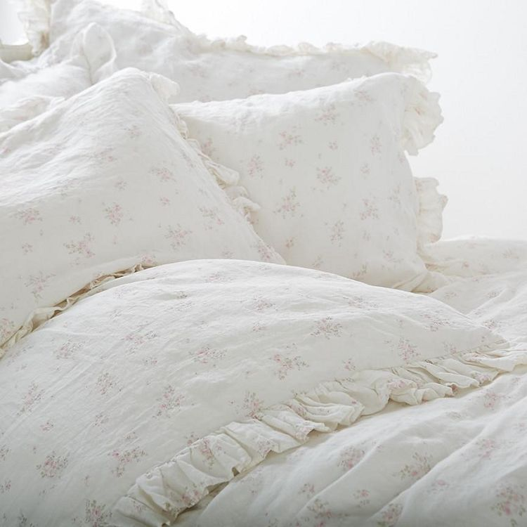 rosabelle bedding collection offers a vintage inspired look through a combination of soft pink flowers over an offwhite linen background