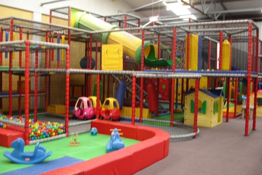 Indoor kids play area colorful interior ideas plastic ball for Indoor playground design ideas