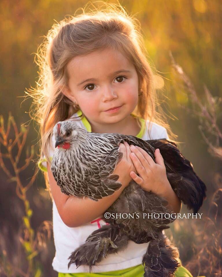 Child holding chicken