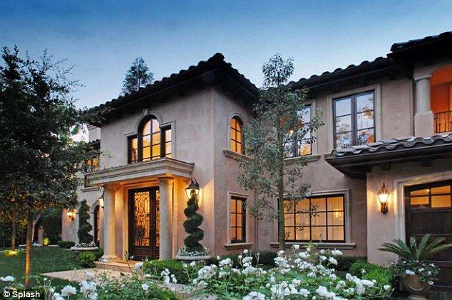 It's a beauty: The Mediterranean villa features lush gardens and a two-story entry way
