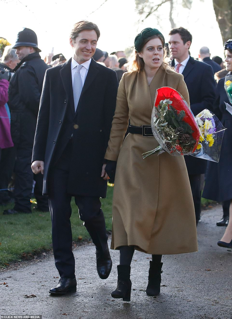 Princesses Beatrice and Eugenie put on a brave face to go