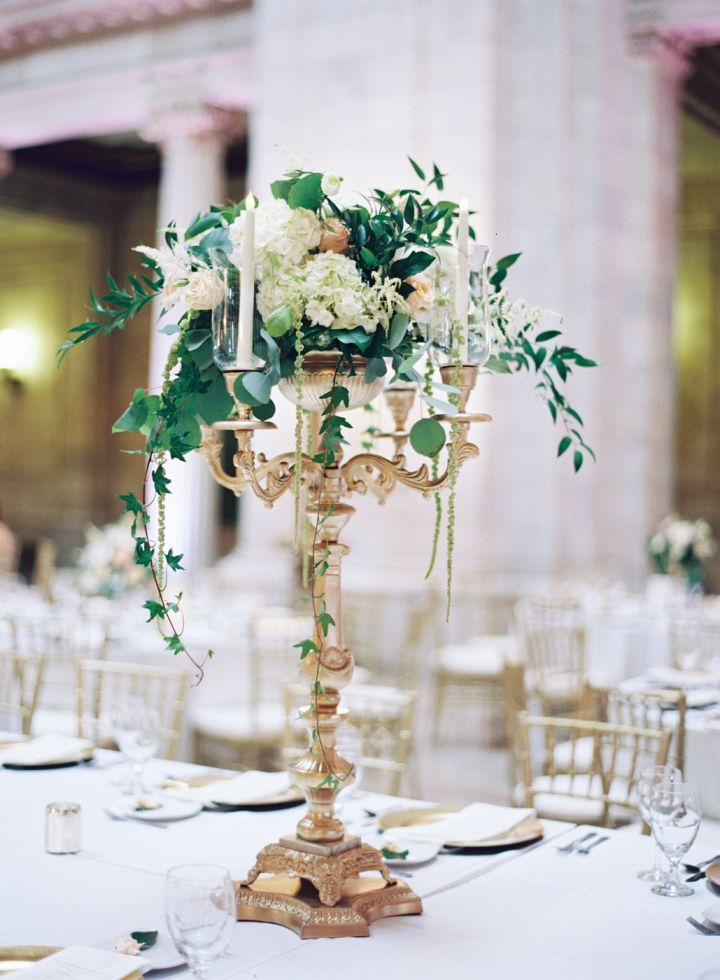 White and gold tall wedding centerpiece idea