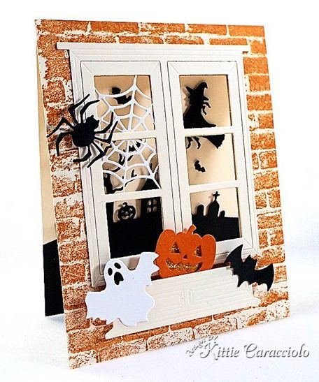 Kittie Caracciolo using Impression Obsession Halloween images and dies. Kittie used the DIE-114-0 Halloween Set, DIE029-P Halloween Hill Die, DIE115-J Spider Web, DIE121-E Ghosts, DIE103-ZZ Lg. Window with Box and CC083 Cover-a-Card Distressed Brick.
