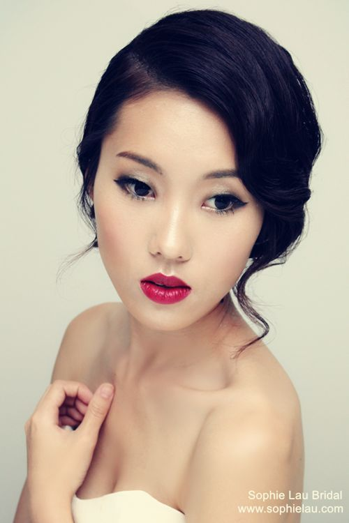 Asian bridal wedding makeup with a red lipstick