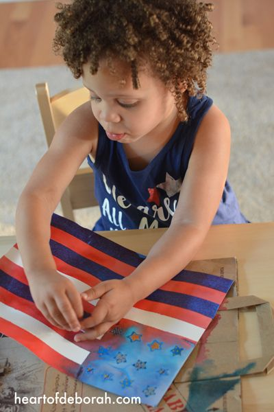 Fun American Flag Kid's Craft! Make this beautiful watercolor with your children for memorial day, the 4th of July or to cheer on Team USA at the olympics. This DIY watercolor is beautiful and easy to make with kids.