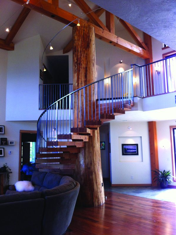 Wood and steel are incorporated into this Alaskan home with a spiral Purple House Designs Stairs on house carport design, house boats design, house frames design, house driveway design, staircase design, house column design, wood stair design, house trim design, house flooring design, house floor design, house flat roof design, house fireplaces design, house doors design, house shelves design, house arches design, rustic stair railing design, house roof garden design, stair step design, house windows, house floor plan with grand staircase,