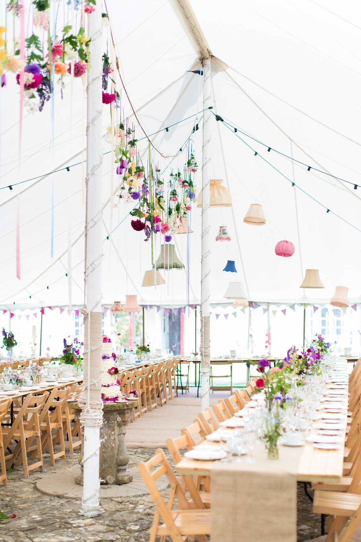 An Essense of Australia Gown and Flower-Filled Village Wedding -  Trestle tables decorated with fresh garden flowers. Photographer – Kerry Bartlett Photography  - #