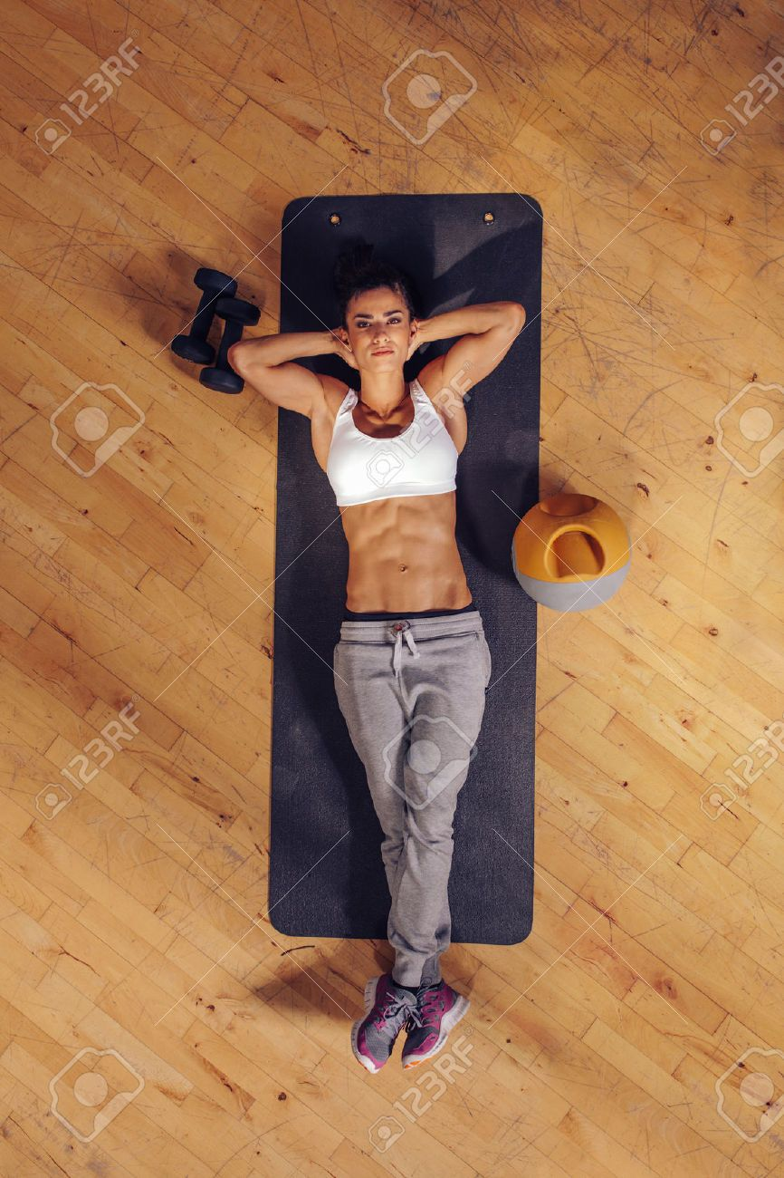 43852687 Top View Of Woman Relaxing On Yoga Mat Fitness Female Lying