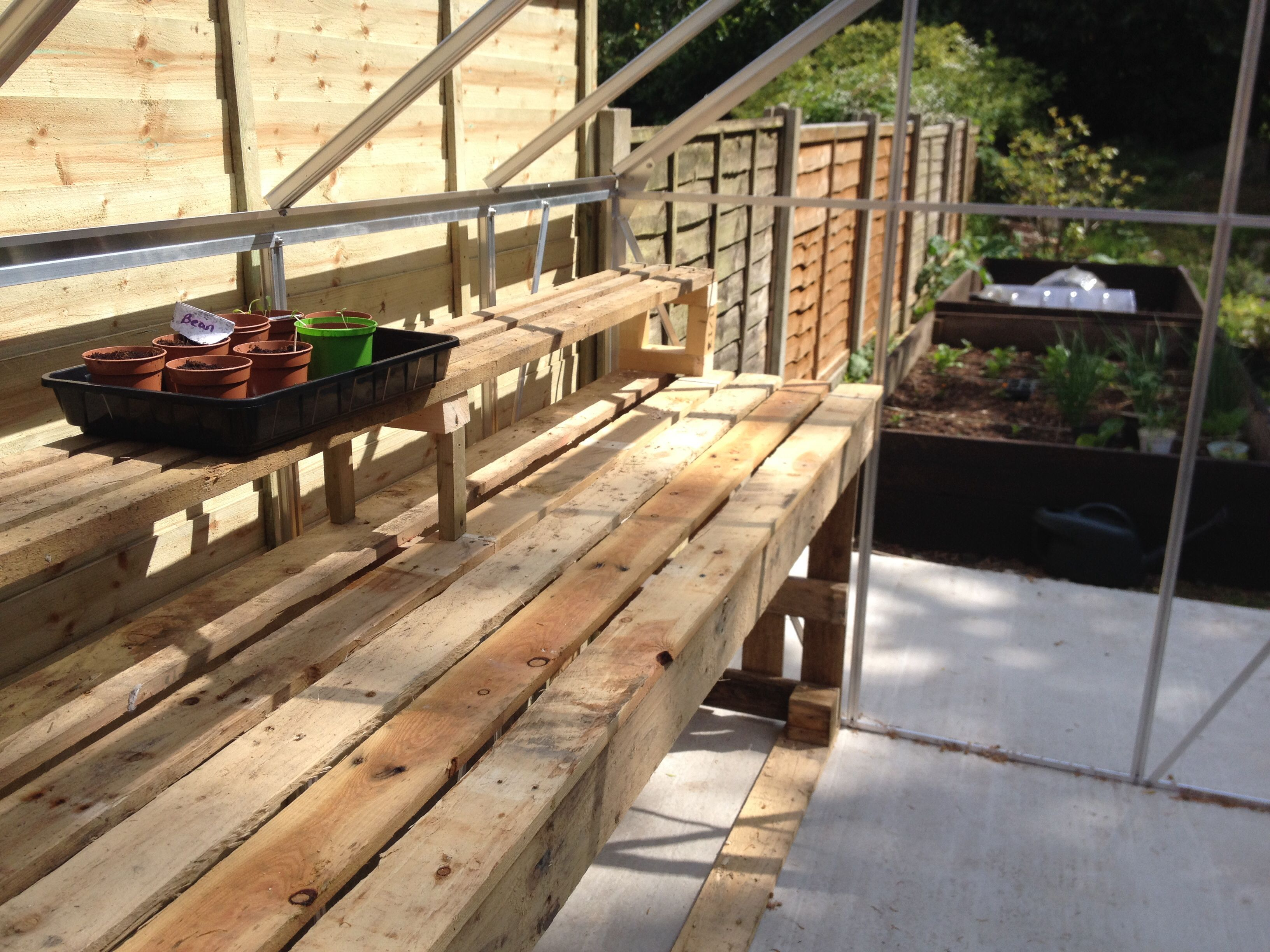 Greenhouse staging made out of pallets greenhouse stuff for Inexpensive greenhouse shelving wood