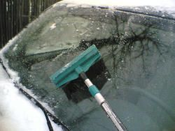 Homemade window de-icer!  Simply mix 3 parts vinegar and 1 part water in a spray bottle.  Apply to all the car windows (including side and rear) before going to bed at night.