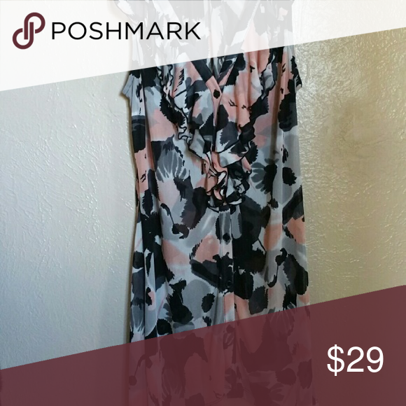 Top Black and peace floral with small ruffle's on collar, sleeveless long shirt. Lightweight, perfect for hot weather. Very feminine, dress it up or dress it down. Tag says size medium. INC International Concepts Tops Blouses