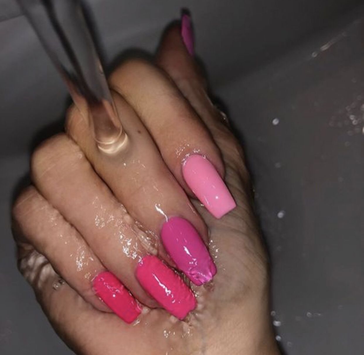 Kylie Jenner's wears various shades of pink nails