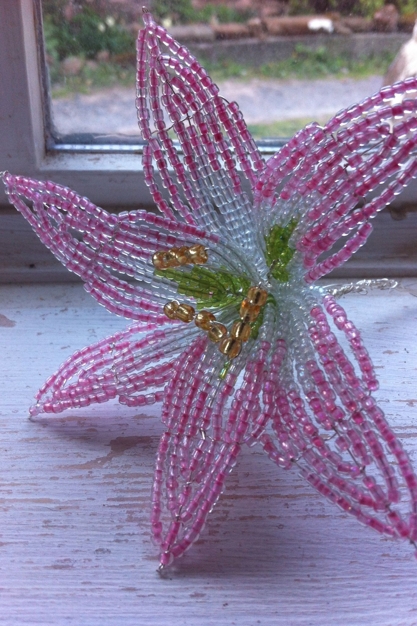 French beaded lilly for inclusion in bridal bouquets a lovely french beaded lilly for inclusion in bridal bouquets a lovely floral keepsake of your wedding day if you want to learn how to make glass flowers then izmirmasajfo