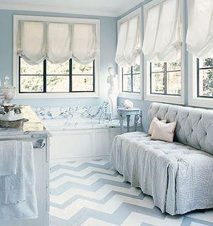 Nice white balloon shades - one per panel of window.