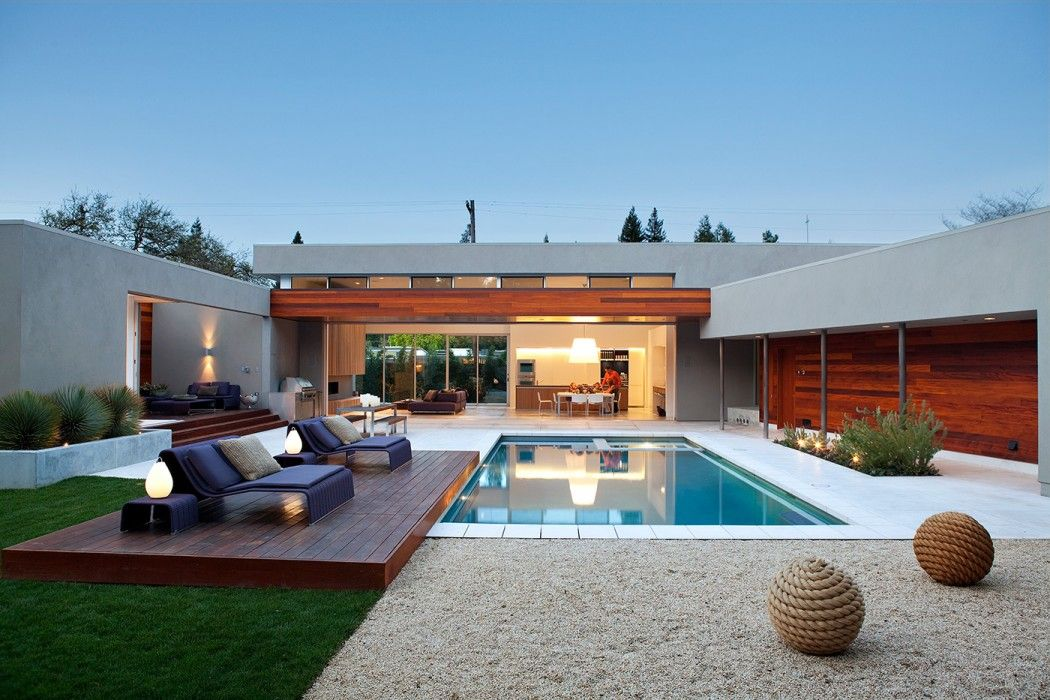 The Architecture Of Home Ball Sculptures And Pool Are All Absolutely Beautiful Surroundings For This Simple Deck In A