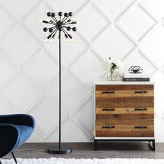 Create a mid-century mood with the dramatic black silhouette of our retro-modern floor lamp. Inspired by industrial design and atomic-age style the sputnik lamp is both lighting and sculpture. It features 10 vintage-style LED bulbs and a foot-step switch. The black satin metal finish is complemented by a silk-wrapped cord. #JonathanY #HomeDecor #Lamps #DesignerLamps #ModernLighting #FloorLamp #LampInspiration  Create a mid-century mood with the dramatic black silhouette of our retro-modern floor