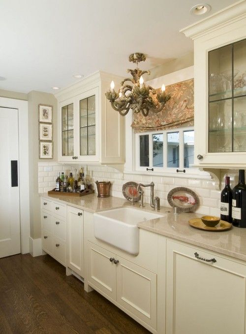 everything- from the farmhouse sink to the lights, to the curtains, to the clear glass cabinets. Love it!
