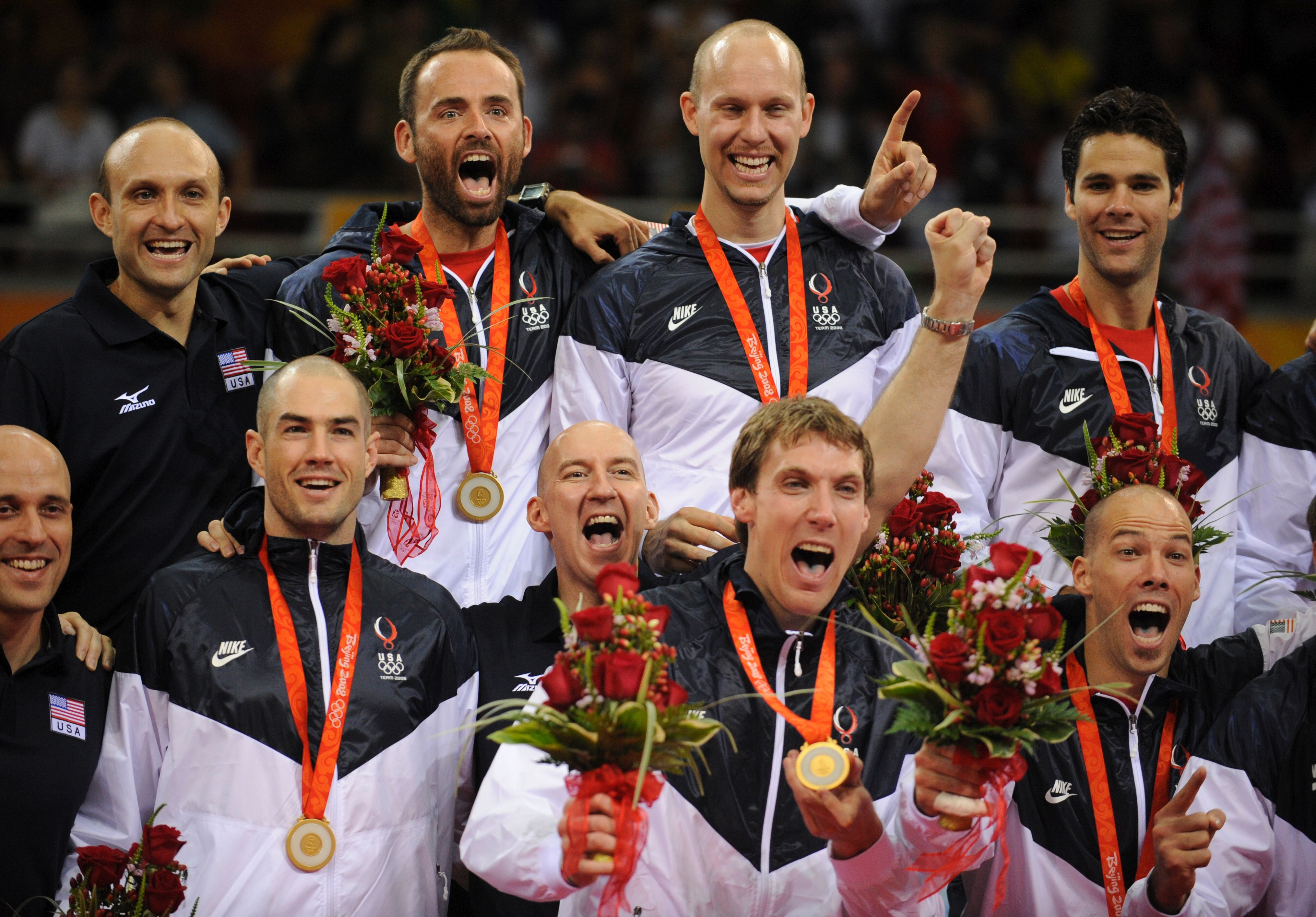 U.S. Volleyball wins gold in 2008 for the first time since 1988, rallying around coach Hugh McCutcheon whose father was murdered during the Games.