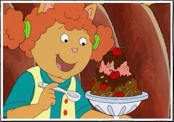 Sue Ellen eating a big ice cream sundae.