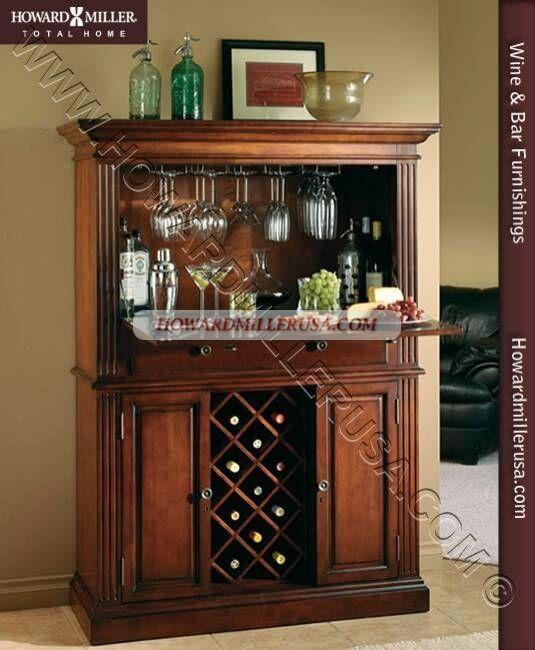 690006 Howard Miller Wine And Bar Furnishings 690 006 Seneca Falls The Drop Down Wooden Door Features A Moist Wine Furniture Corner Wine Cabinet Wine Cabinets