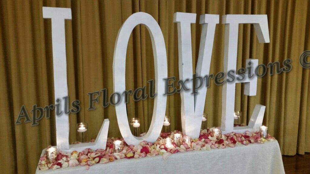 LOVE : An intense feeling if deep affection  #bestsilkflorist #charlottesilkflorist #silkflowers #charlotteweddings #weddings #lovesign #aprilsfloralexpressions