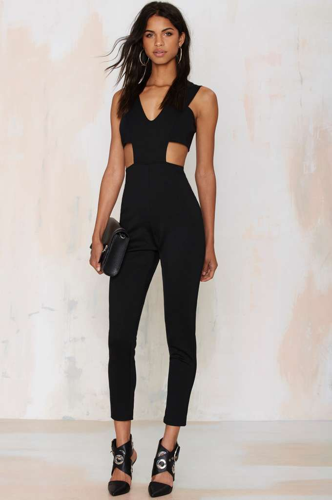 65c78afd5ca9 Show off every one of those curves in this black jumpsuit featuring cutouts  at sides