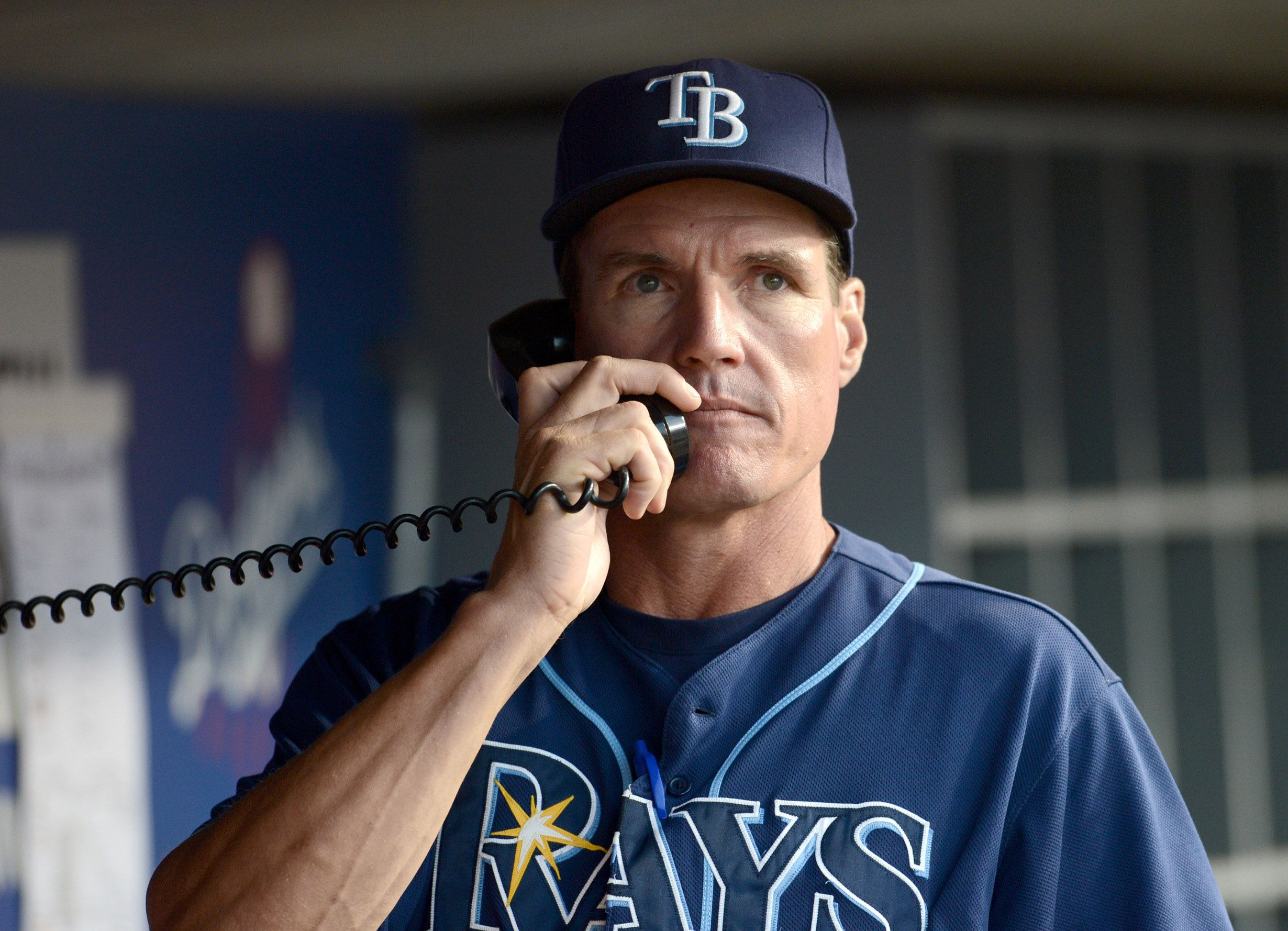 Tampa Bay Rays Pitching Coach Jim Hickey Makes A Call To The Bullpen During The Game Against The Los Angeles Dodgers At Tampa Bay Rays Tampa Bay Dodger Stadium