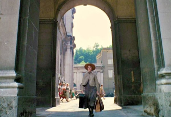"""If you blinked during the """"I Have Confidence"""" scene—when Maria is leaving the convent for the Von Trapp home—you may have missed a very special extra. The real Maria von Trapp, her daughter and granddaughter appear for a split second in the background."""