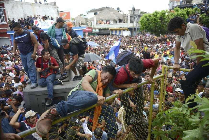 Honduran Migrant - Oliver de Ros AP Photo  e3623b06be6