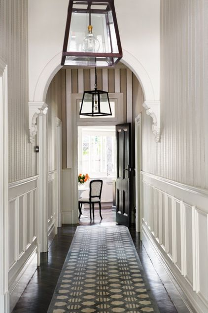 Arch and Wainscot Transitional Hall by Bloom Interior Design