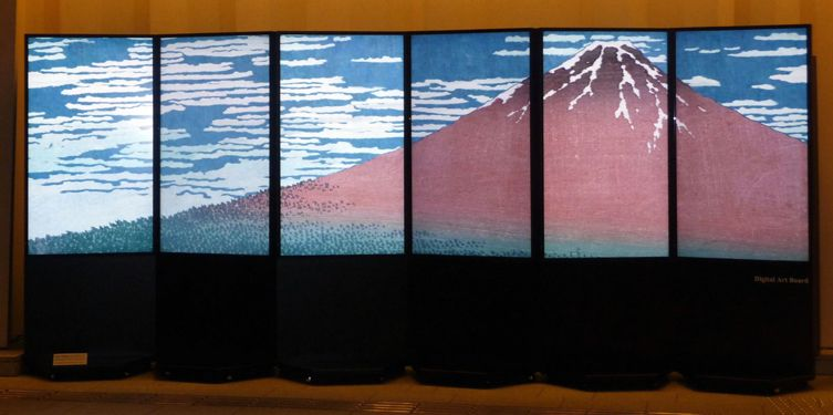 #Excogitare -A single Matrox M9188 graphics card drives a six-monitor Digital Art Board in Tokyo Midtown.