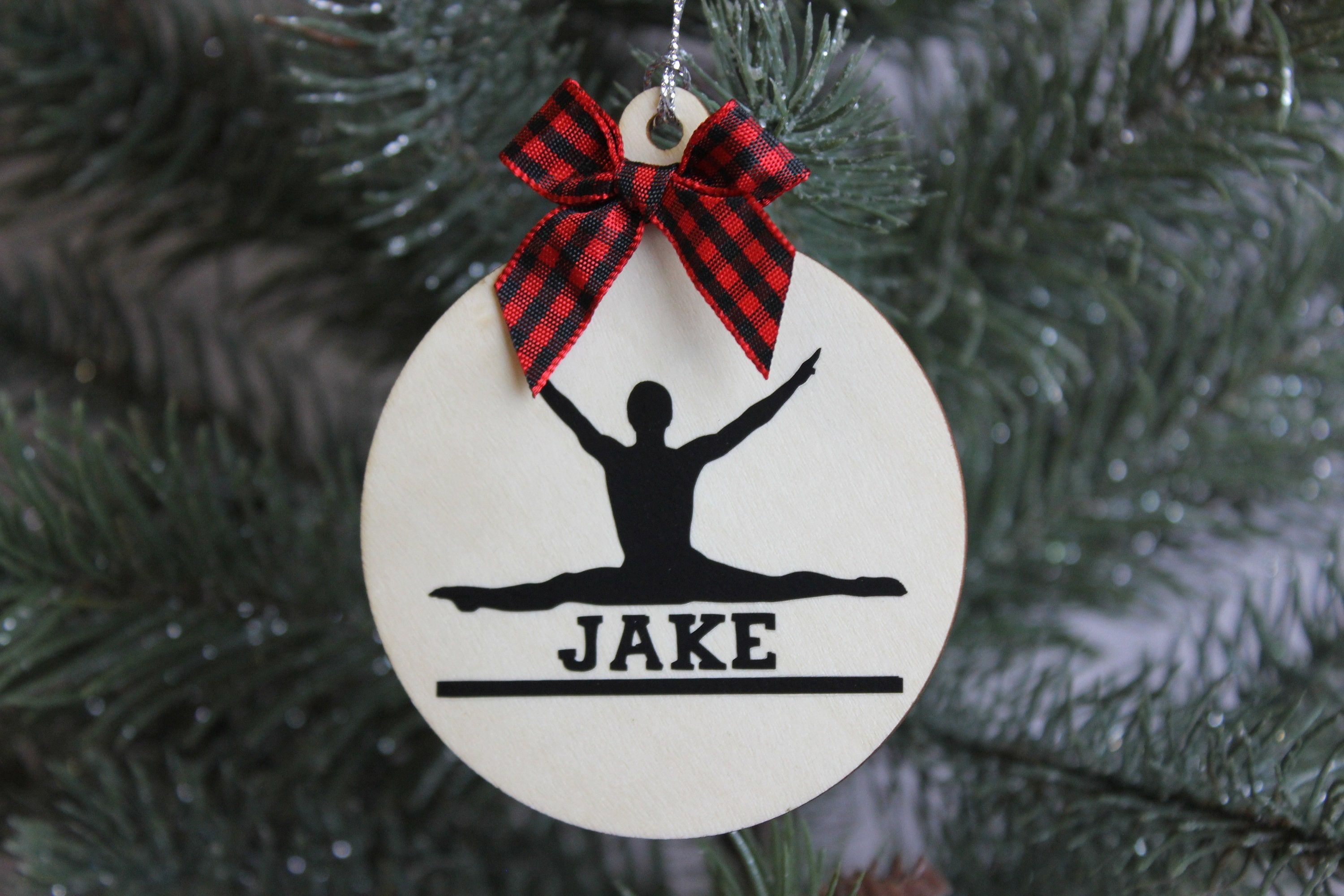 The ornament is made of a natural wood, heat transfer vinyl, ribbon, and lots of love:). They are approximately 2.7 - 3.5 inches in diameter and 2.5 mm thick. They come with tinsel string for easy hanging. All ornaments will come in a decorative bag for easy gift giving. *DISCLAIMERS* This is not a toy. For decoration only.