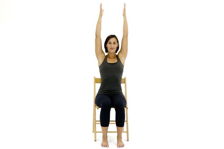 10 Yoga Poses You Can Do In A Chair Chair Yoga Chair Pose Yoga Hatha Yoga Postures