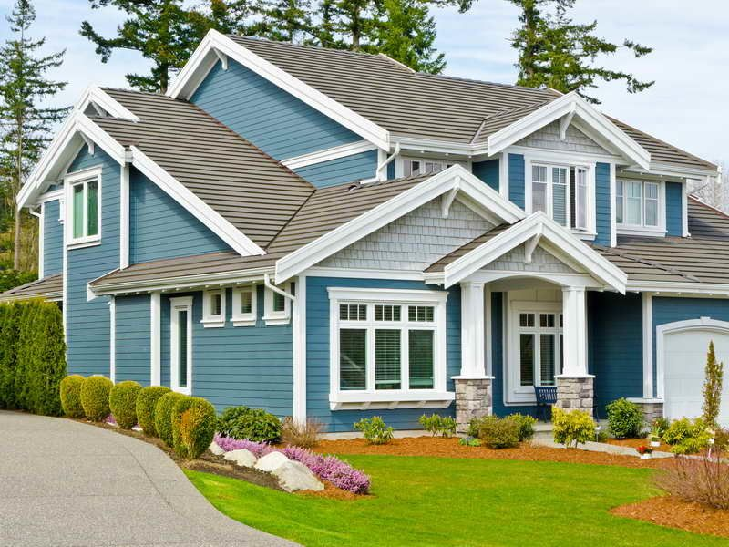 Vibrant Blue Exterior With White Trim And Light Roof Roof And