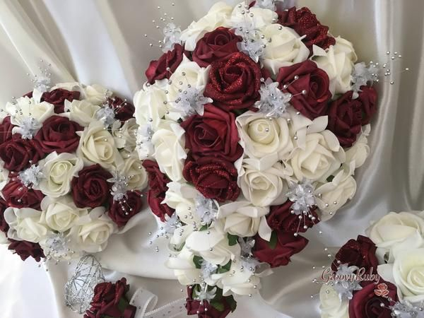 This new package adds shimmer and sparkle to a classic GroovyRuby design. They are made up of ivory & glitter encrusted burgundy roses, enhanced by groups o