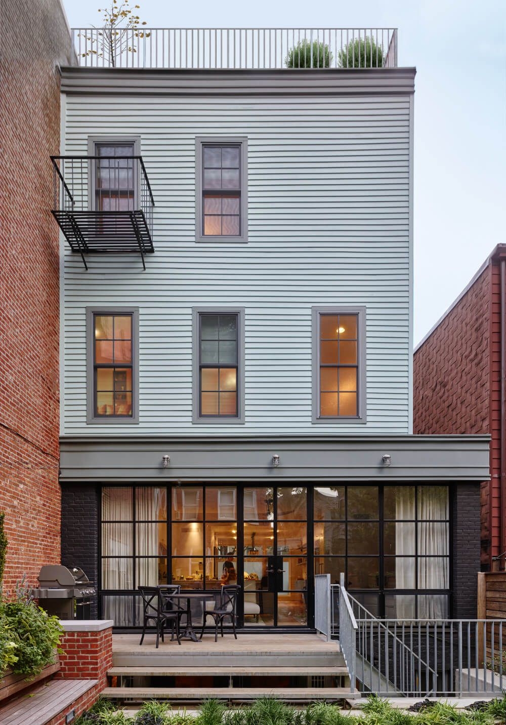 Greenpoint row house modern home in new york by delson or  on dwell also east williamsburg rowhouse  wood frame rh pinterest