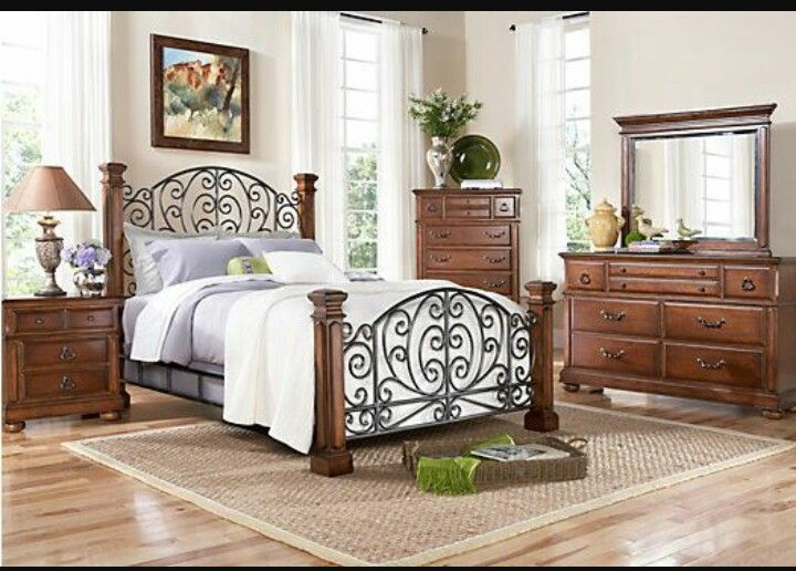 Charleston bed at rooms to go i love the mix of wrought iron and wood home furnishings for Wrought iron and wood bedroom sets