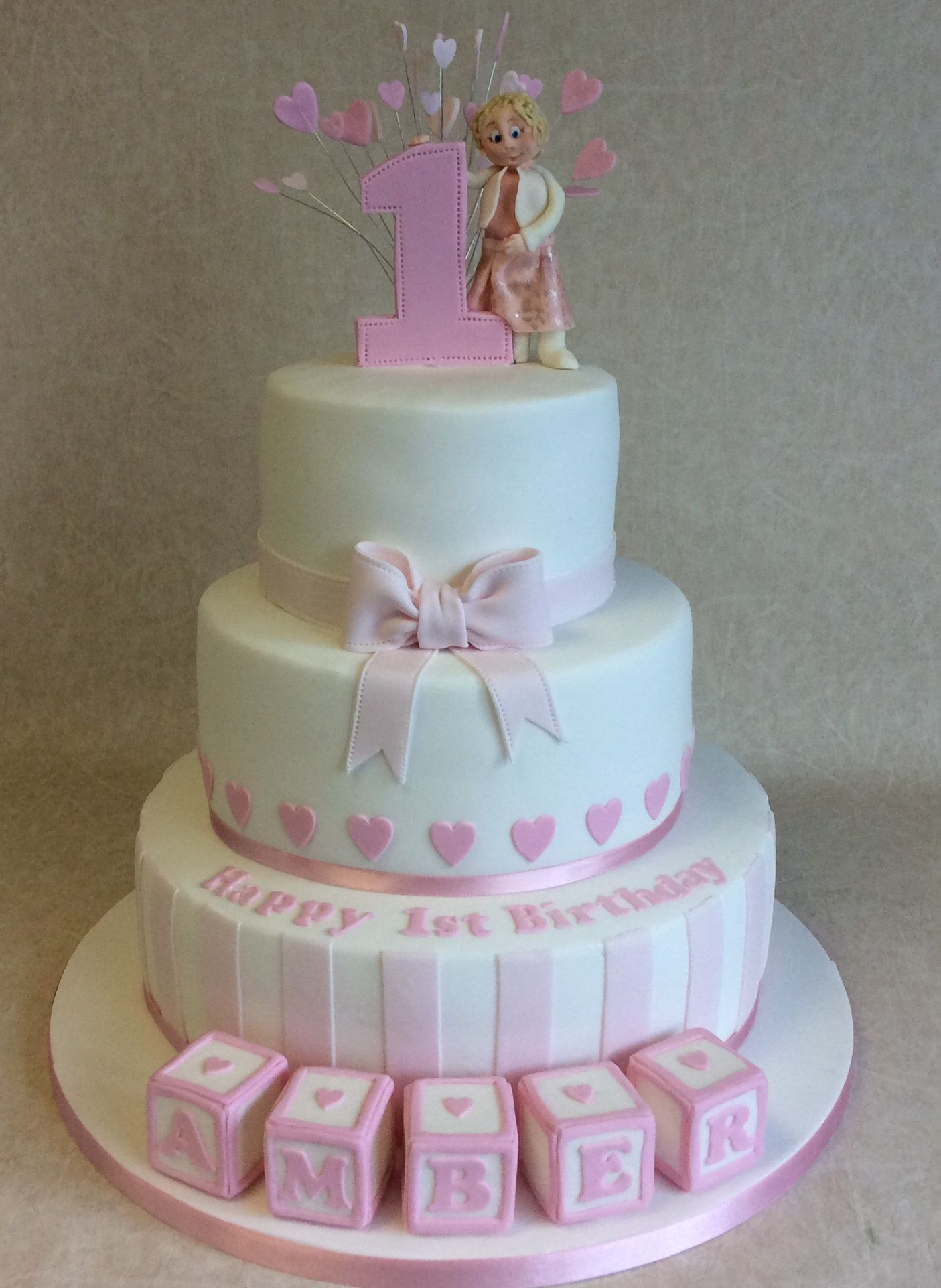 3 Tier Blocks And Stripes 1st Birthday Cake In Classic Baby Pink And