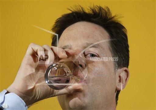 Nick Clegg, leader of Britain's Liberal Democrat party takes a drink of water at a press conference in London, Tuesday, April 28, 2015. Britain goes to the polls on May 7 to elect a new parliament. (AP Photo/Kirsty Wigglesworth)