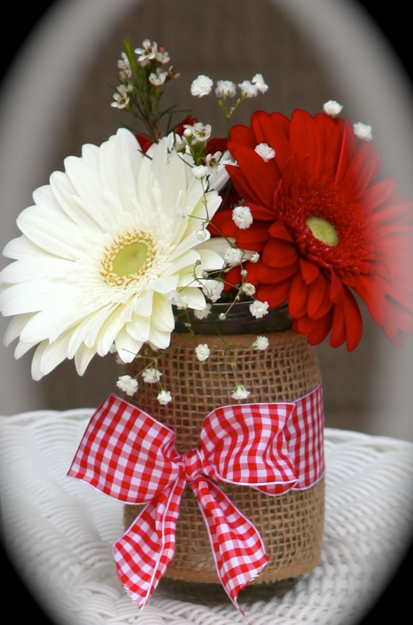 One of the mason jars with gerber daisies and babyus breathpink