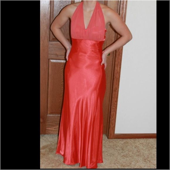 "Formal gown Simply pretty in a coral orange. Has a ruffle down the back; very comfortable. I am 5'3"" and could wear low-medium heels with it. Only worn one time and in excellent condition. Good for a prom or gala Dresses"