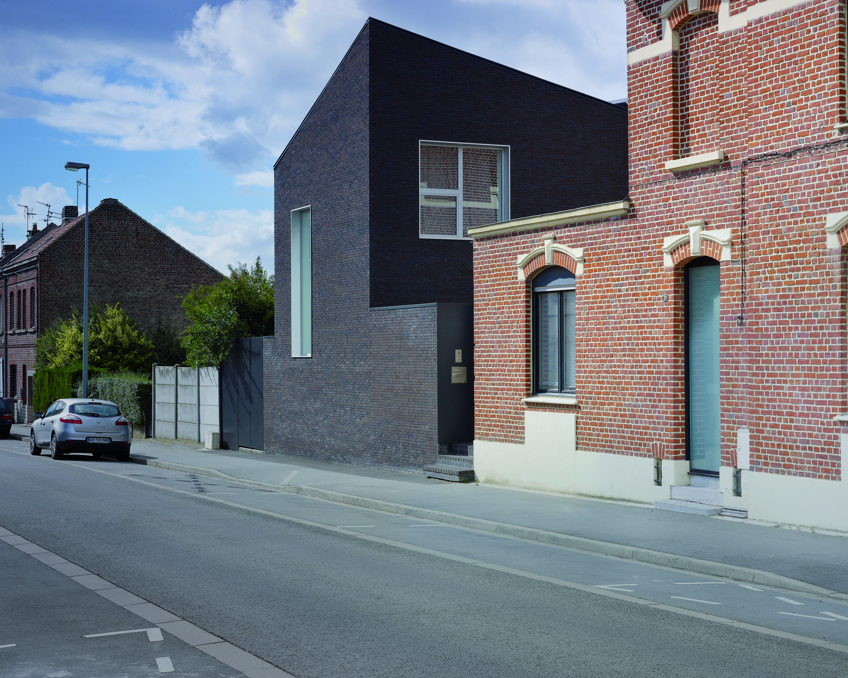 French Architect Emmanuelle Weiss Has Added A Contrasting Dark Brick