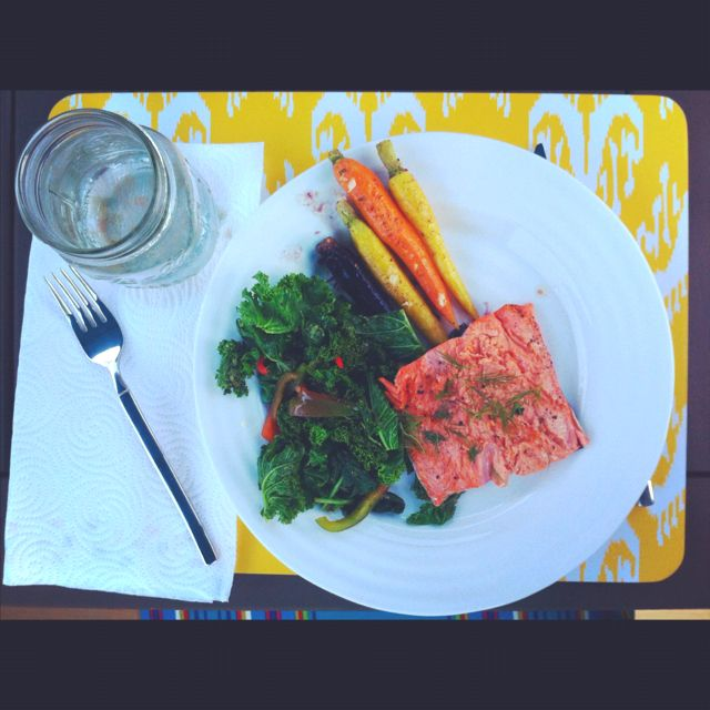 Grilled salmon with dill, sautéed spinach and kale with peppers, and honey glazed heirloom carrots.