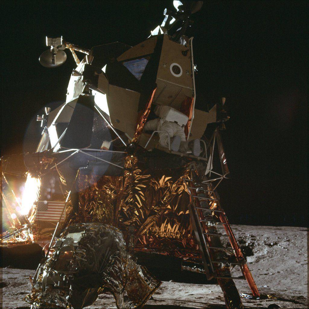 An Apollo 12 crew member leaving the Lunar Lander. | Lunar ...