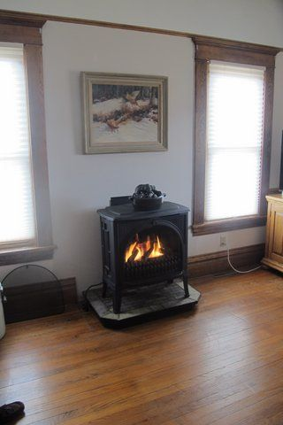 valor madrona mf28jln direct vent gas cast iron stove installed on raised hearth on