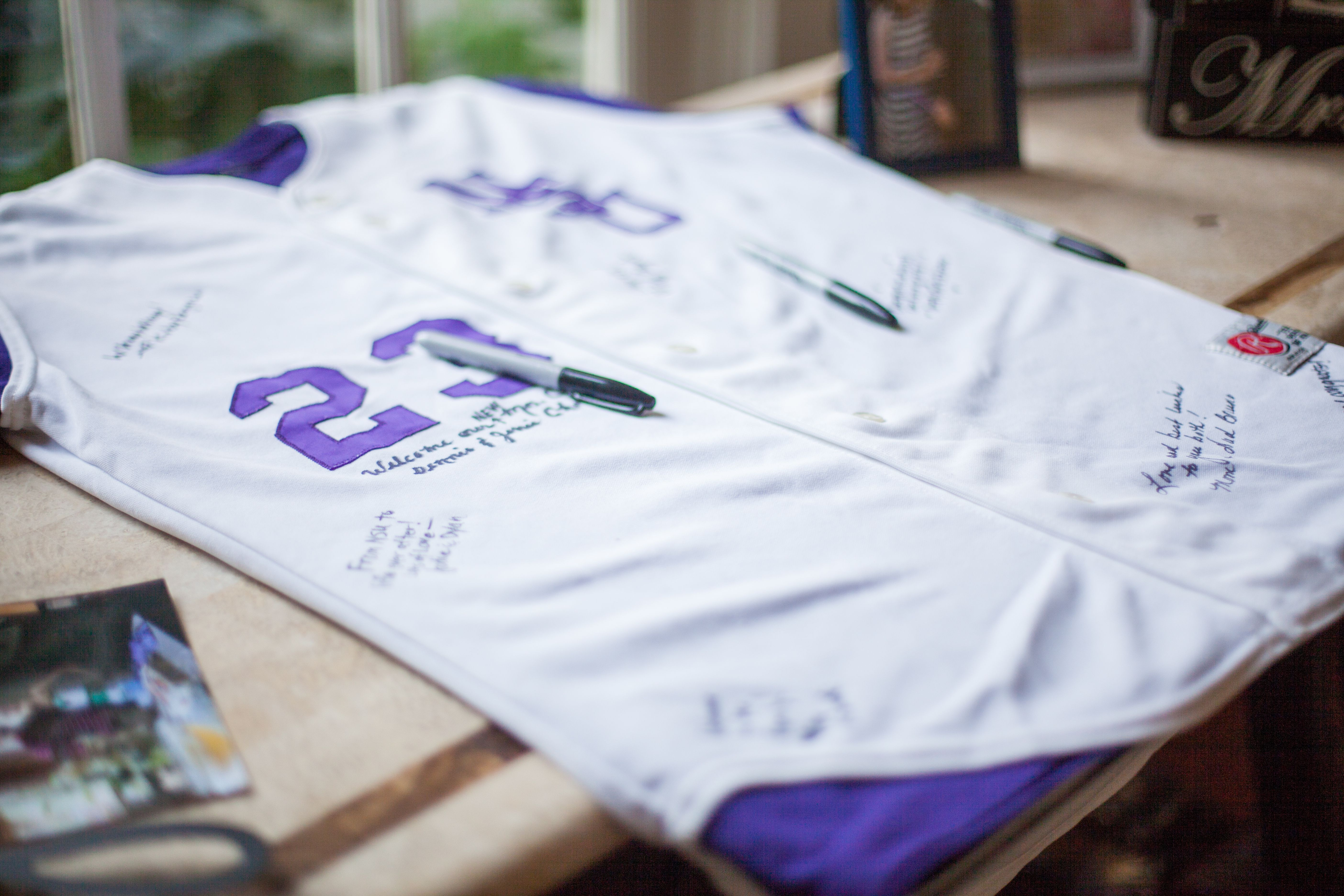 Denny played baseball and Cary played softball, so guests signed their jerseys as they walked into the reception.
