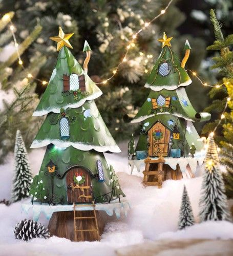 Miniature Fairy Garden Lighted Christmas Tree Houses  Set of 2, Grey is part of garden Lighting Tree - Our Miniature Fairy Garden Lighted Christmas Tree House is the perfect seasonal accent for your fairy garden, miniature display or indoor holiday decor  Each tree features windows and star cutouts, functional front door, holly accents, chimney, plus a star on top for the perfect finish  Batteryoperated lights on a timer  Painted metal; use indoors or out  Set of 2, one each small and medium sizes  Size OneSize